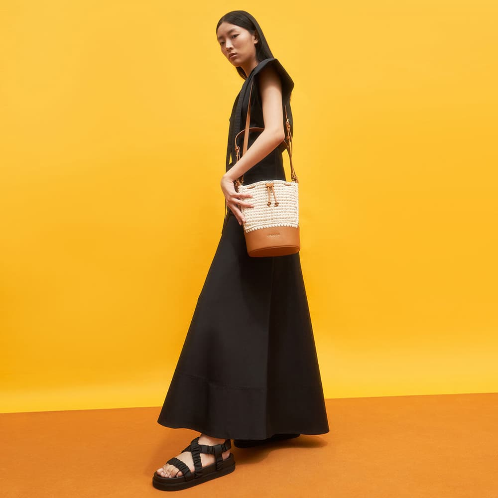 Women's black grosgrain ruched crossover sandals and cognac crochet drawstring bucket bag - CHARLES & KEITH