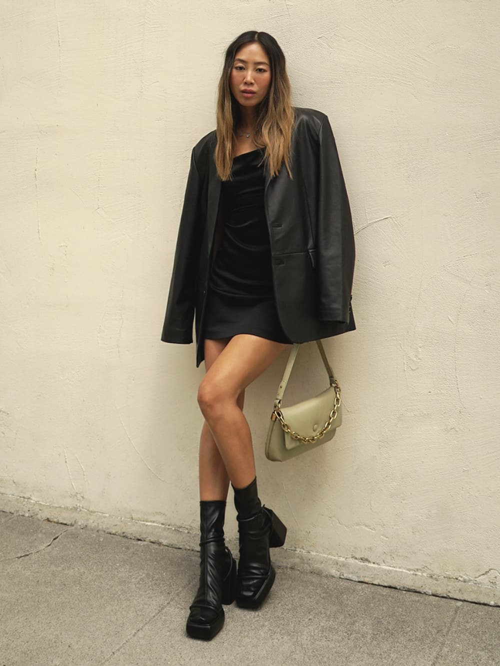 Women's taupe Zadie padded shoulder bag and black Lucile platform calf boots, as seen on Aimee Song - CHARLES & KEITH