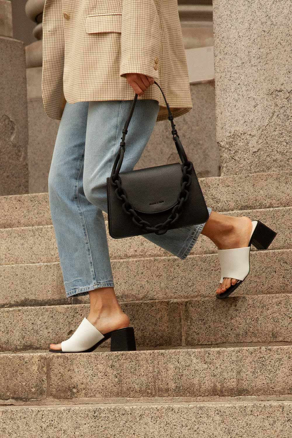 Women's toe loop chunky heel mules in white and women's chunky chain link shoulder bag in black - CHARLES & KEITH